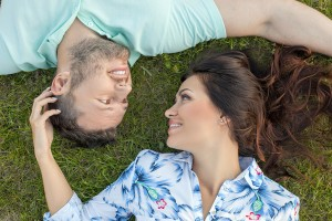 Cheerful young loving couple is relaxing in the nature