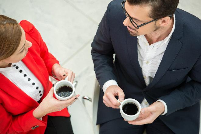 bigstock-Business-man-woman-hutari-coffe-cap-kyuukei